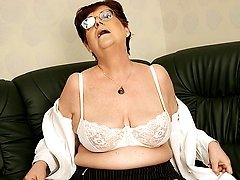 Horny mature masturbating slut with a dildo