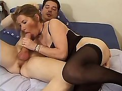 Aged mature in black stockings sucking big dick