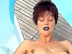 Mature gets cool licking by pool