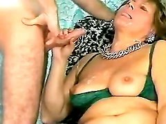 Hot mature gets cumshot on her tits