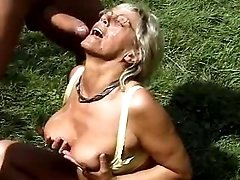 Sex addicted granny fucks in nature