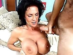Lusty granny gets cum on huge boobs